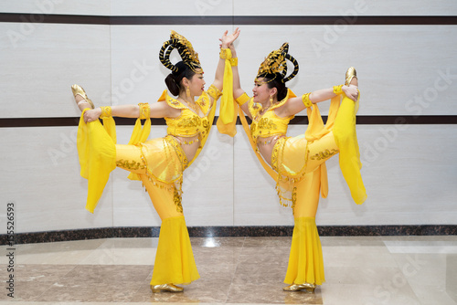wo beautiful girl actress in yellow traditional chinese stage costumes standing Poster