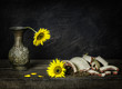 Classic still life with sunflowers placed on rustic wooden background.Brokenness concept