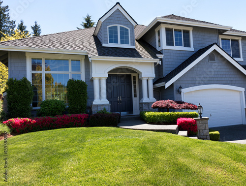Well maintain front lawn of clean home during spring season