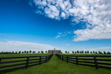 Fence Leading to Barn on Sunny Day - 155620560