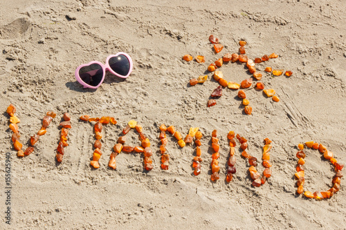 Foto Murales Sunglasses, inscription vitamin D and shape of sun at beach, concept of summer time and healthy lifestyle