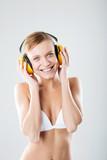 Emotional woman in yellow headphones.