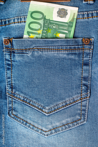 Poster 100 euro note in a blue jeans pocket