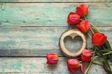Background with red tulips and wooden hearts on old wooden boards. - 155717749