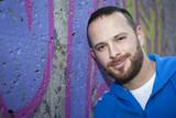 young man at a graffiti wall