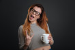 Confident active girl rocking morning coffee