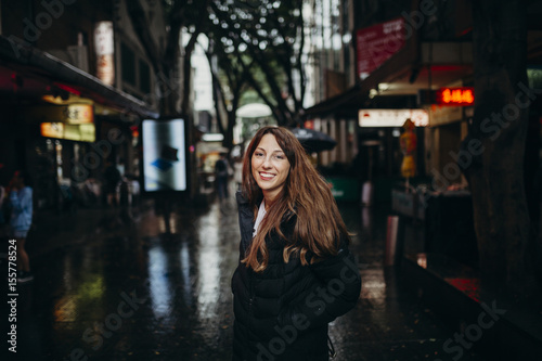 Aluminium Sydney Smiling woman enjoying chinatown neighborhood in Sydney, Australia