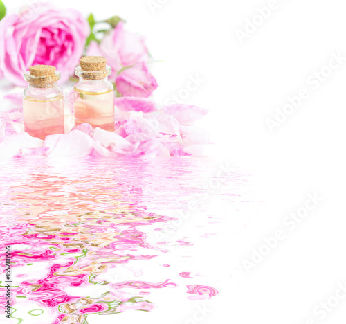 Rose essential oil reflected in the water Poster