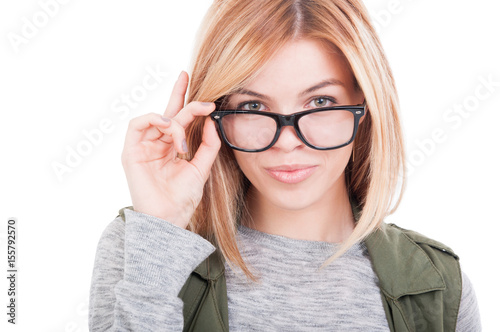 Portrait of sexy woman holding her glasses