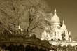 View of Sacre Coeur Basilica and an old carousel at foreground (Paris, France). Sepia.