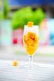 Peach Mango Smoothies or Milkshakes in Glasses with Ingredients