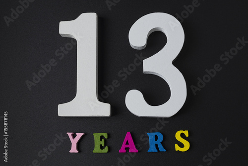 Poster Letters and numbers thirteen on a black background.