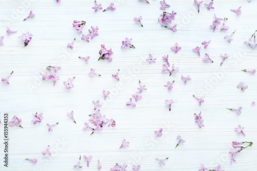 Lilac flowers on white wooden table