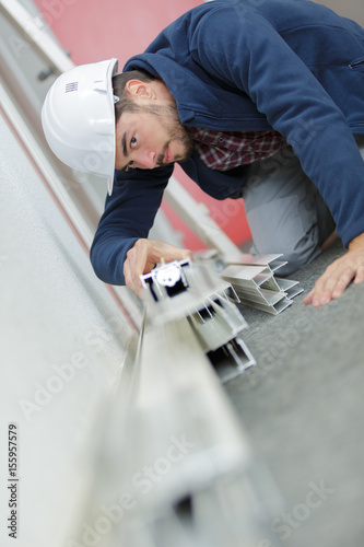 Man examining pvc window and door frames - 155957579