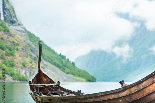Fotobehang Schip Old wooden viking boat in norwegian nature
