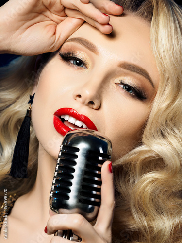 Portrait of beautiful blond female singer Poster