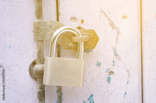 Metal padlock on wooden door, closeup. Nobody Poster