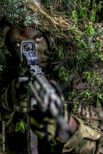 Camouflaged soldiers in forest