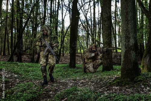 Fototapeta Camouflaged soldiers in forest