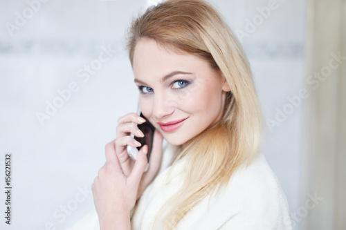 Blonde woman calling in bathroom