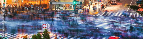 Staande foto Tokio Crowds converge at Shibuya Crossing in Tokyo, Japan
