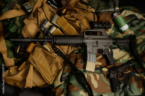 Fotobehang Jacht Assault rifle carbine with tactical chest rigs. Military Equipment.