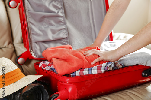 travel suitcase on sofa Poster