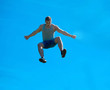 Jumping up guy. Background blue sky.
