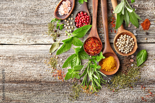 Fototapety, obrazy : Herbs and spices on a wooden board