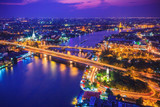 Bangkok city skyline and Chao Phraya River under twilight evening sky.