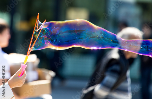Beautiful soap bubbles fly in the city - 156312932