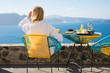Woman enjoying morning in luxury hotel in Santorini