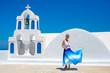Woman dancing in Santorini island, Greece