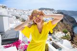 Tourist girl having fun time in Santorini - 156344507