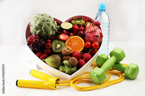 Healthy lifestyle concept. healthy food and sport fitness equipment, dumbbells , jumping rope