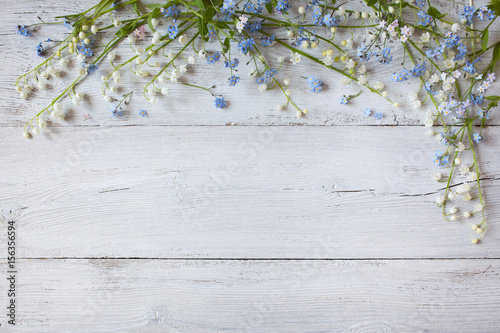 Fotobehang Lelietjes van dalen Spring flowers of lilies of the valley, forget me not on a wooden background