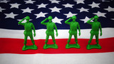 Toy soldiers on the American flag - 156396355