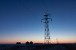 Transmission Tower Silhouetted at Sunset