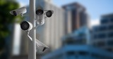 CCTV cameras against defocused buildings