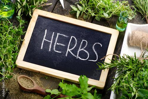 Garden fresh herbs on a wooden table