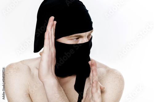 Portrait of ninja man in a black mask on white background Poster