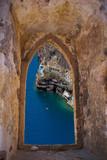 Santorini island through an old Venetian window, Greece
