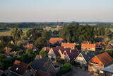 High angle view of dutch rural village lit by early morning sun.
