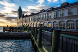 Scenic views of Pier A in Battery Park New York City during dramatic sunset