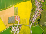 Aerial view to urban landscape in Czech countryside. Fields, farm and small village Luzany in Czech Republic, Central Europe.