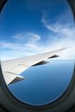 plane window high on the blue skies