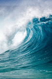 Big breaking Ocean wave on the north shore of Oahu Hawaii