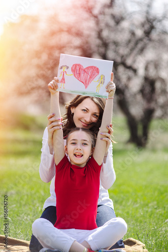 Happy young mother with her daughter at park