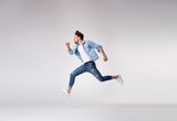 Stylish, handsome man running - isolated