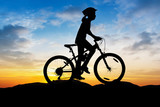 Girl cycling at mountain twilight time